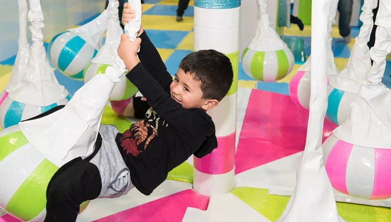 little boy playing at indoor playground